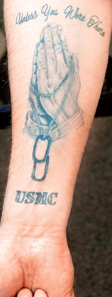and a Marine Corps tattoo
