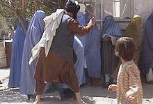 220px-Taliban_beating_woman_in_public_RAWA