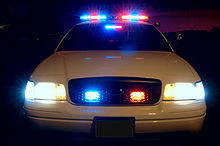 220px-Police_car_with_emergency_lights_on
