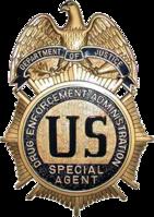 141px-DEA_badge_C