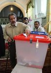 200px-Voter_Cast_his_vote_in_ballot_box-_Iranian_presidential_election,_2013_in_Sarakh_3